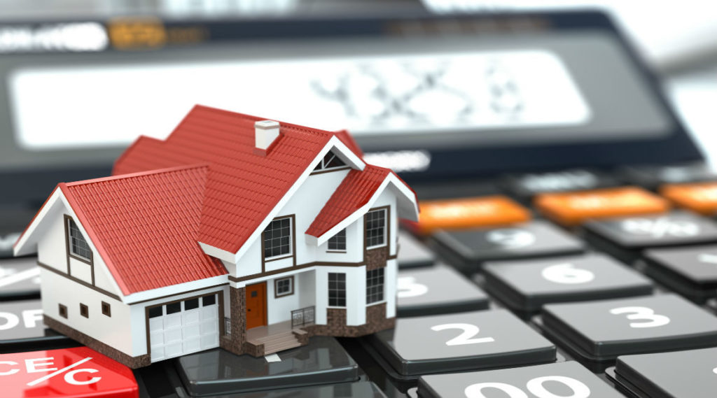 Image depicting commercial mortgage rate calculator with a house and a calculator